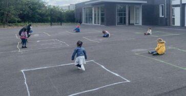 Socially distanced children in playground