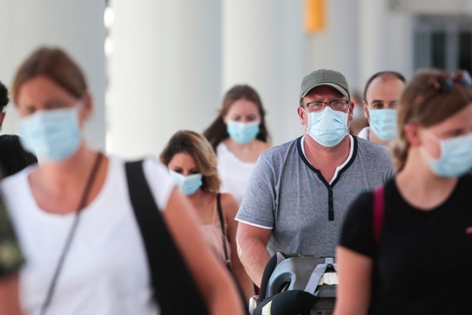 Disembarking an airport wearing masks